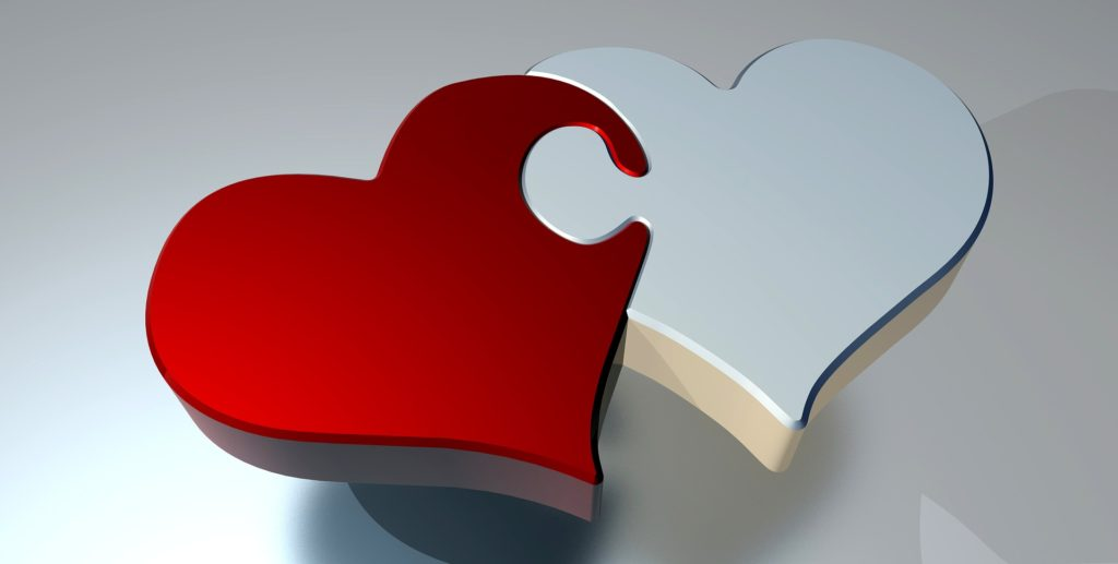 Picture of two hearts joined like puzzle pieces